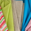 Pile of different fabrics close-up background — Stock Photo #37724985
