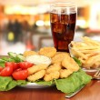 Fried chicken nuggets with vegetables,cola,french fries and sauce isolated on white — Stock Photo