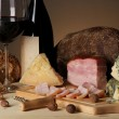 Exquisite still life of wine, cheese and meat products — Stock Photo #37725381