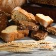 Much bread on wooden board — Stock Photo #37725795