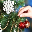 Decorating Christmas tree on bright background — Stok fotoğraf #37726719