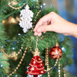 Decorating Christmas tree on bright background — Stok fotoğraf #37726763