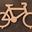 Stock Photo: Decorative bicycle on wooden background background