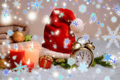 Composition with plaids, candles and Christmas decorations, on white carpet on bright background — Foto Stock