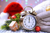 Composition with retro alarm clock and Christmas decoration on bright background — Foto de Stock