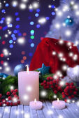 Candles and Christmas decoration on bright background — Foto de Stock