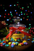 Paper stars with dreams on table on dark background — Stock Photo