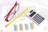 Documents, calculator and glasses close-u — Stock Photo