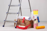 Metal ladder and paint in room — Stock Photo