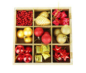 Wooden box filled with christmas decorations, isolated on white — 图库照片
