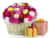 Beautiful bouquet of chrysanthemums in wicker basket isolated on white — 图库照片