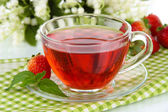 Delicious strawberry tea on table close-up — Stock Photo