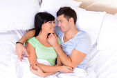 Couple in love sleeping in bed — Stock Photo