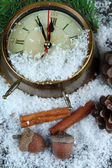 Clock and fir branches under snow close up — Stock Photo