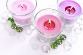 Beautiful colorful candles isolated on white — Stock Photo