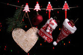 Christmas accessories on black background with lights — Foto Stock