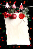 Blank sheet with Christmas decor on black background with lights — 图库照片