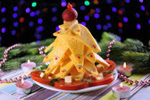 Christmas tree from cheese on table on dark background — 图库照片