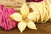 Decorative straw for hand made and flower of straw, on wooden background — Stock Photo