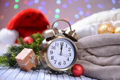 Composition with retro alarm clock and Christmas decoration on bright background — Stockfoto