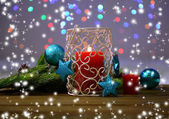 Candles and Christmas decoration on bright background — Stockfoto