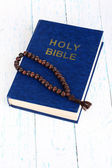 Bible with cross on wooden table close-up — Stock Photo
