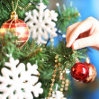 Decorating Christmas tree on bright background — Stok fotoğraf #37778853