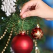 Decorating Christmas tree on bright background — Стоковое фото