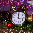 Stock Photo: Wine glasses, retro alarm clock and Christmas decoration on bright background
