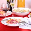 Table with festive dishes after feast close-up — Stockfoto #37779411