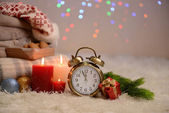 Composition with plaids, candles and Christmas decorations, on white carpet on bright background — ストック写真