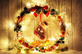 Beautiful Christmas wreath, on wooden background — 图库照片