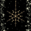 Christmas sparklers in shape of snowflake on black background — Stock Photo