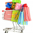 Christmas gifts and shopping in trolley isolated on white — Stock Photo #37780639