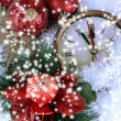 Clock and Christmas decorations under snow close up — Stock Photo
