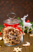 Delicious Christmas cookies in jar on table on brown background — Photo