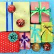 Many colorful presents with luxury ribbons on color background — Stock Photo