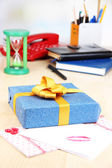 Gift with card for loved one on desktop close-up — Stock Photo