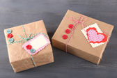 Paper gift boxes on wooden background — Stockfoto