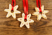 Delicious Christmas cookies on wooden background — Stock Photo