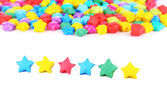Paper stars with dreams on white background — Stock Photo