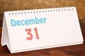 New Year calendar on shiny golden background — Stock Photo
