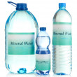 Different water bottles with label isolated on white — Stock Photo