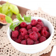 Raspberries in small bowl on napkin isolated on white — Stock Photo