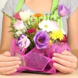 Florist makes flowers bouquet — Stock Photo #37842085