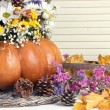Beautiful autumn composition in pumpkin with bumps and decorative box on table on wooden background — Foto Stock #37842321