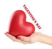 Coração vermelho na mão da mulher, isolado no branco — Fotografia Stock