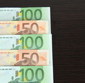 Euro banknotes on wooden background — Stock Photo