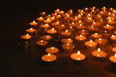 Burning candles on dark background — Stock Photo