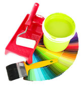 Set for painting: paint pot, brushes, paint-roller and palette of colors isolated on white — Stock Photo